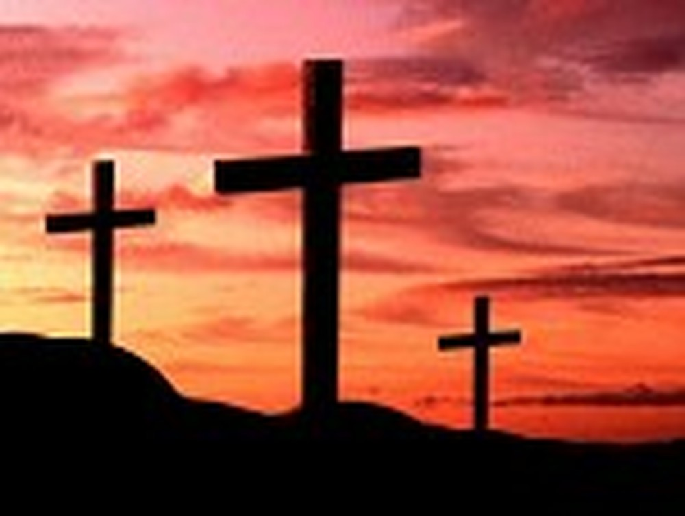 Three Crosses in Front of a Red Sky