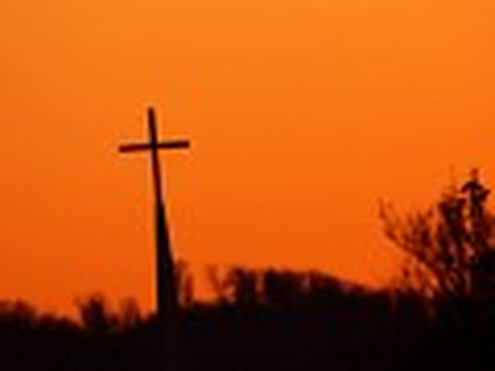Cross in the Distance with an Orange Sky