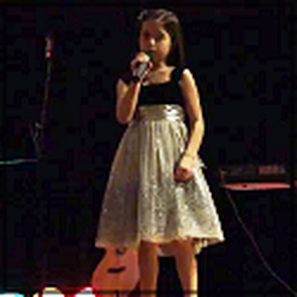 7 Year Old Girl Beautifully Sings O Holy Night at Church