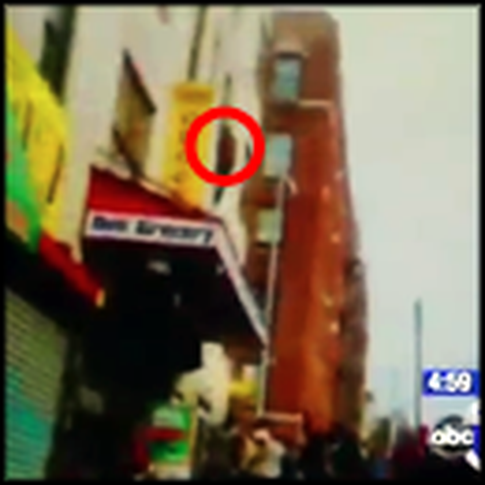 Man Jumps From a Burning Building and is Saved - Caught on Tape