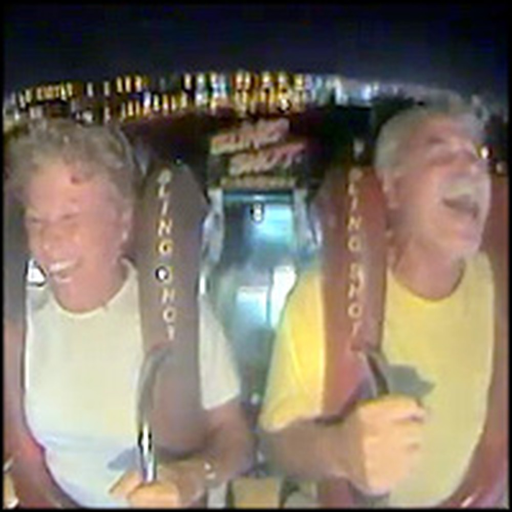 Older Couple Has a Blast on a Amusement Park Ride