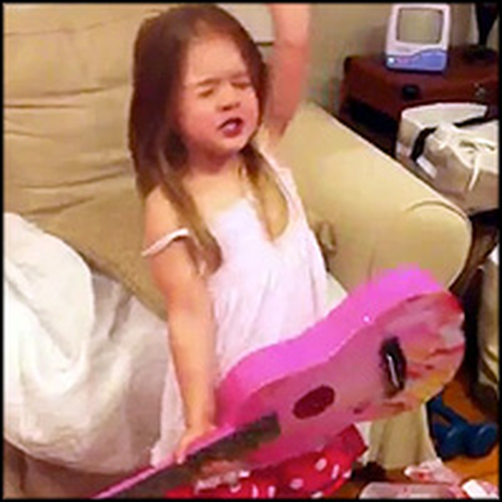 Cute 4 Year Old Rocks Out After Getting a Birthday Present