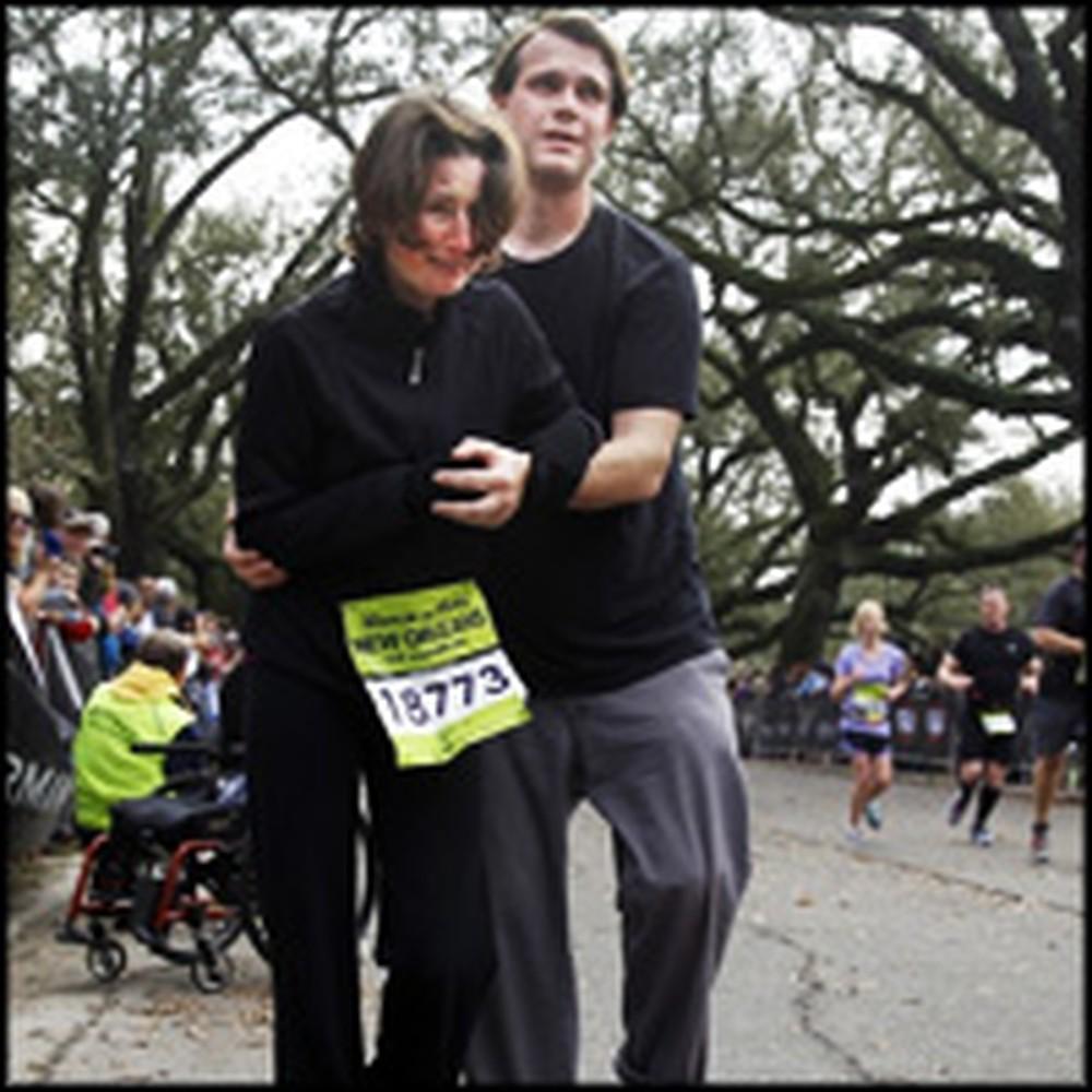 Boyfriend Helps his Semi-Paralytic Girlfriend Cross a Marathon Finish Line