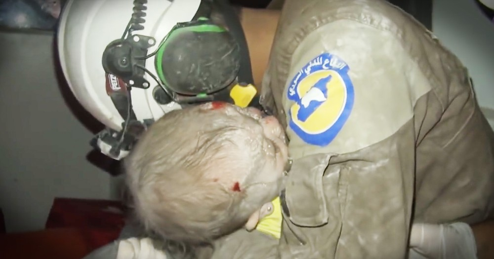 Rescuer Sobbs As The Baby He Rescued Comes Back To Life In His Arms