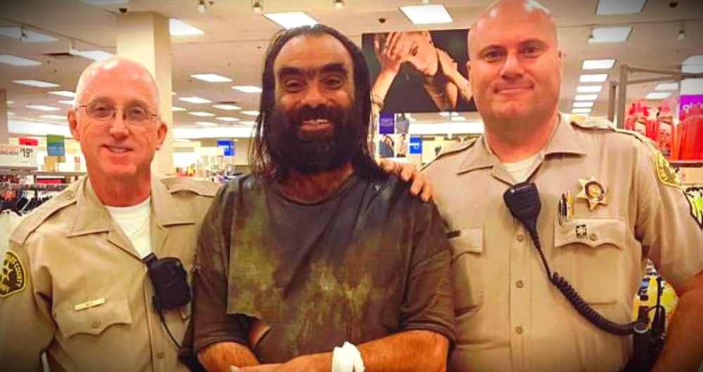 Woman Spots Police Officers Walking A Homeless Man Through A Store