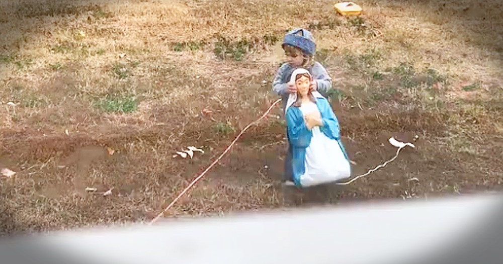 Sweet Little Boy Doesn't Want Mary, Joseph And Baby Jesus To Be Cold Outside