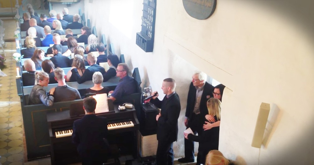 Young Man Sing's Touching Version Of 'You Raise Me Up' At His Big Brother's Funeral