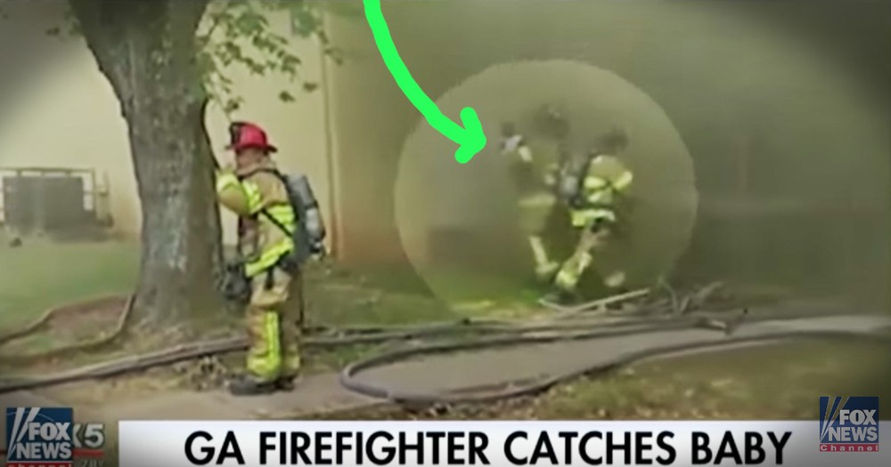 Watch This Firefighter Catch A Baby Thrown From A Burning Building