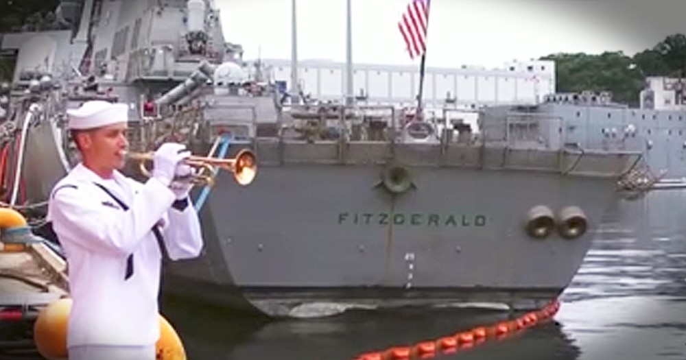 Sailor Plays Taps In Honor Of Fallen Shipmates