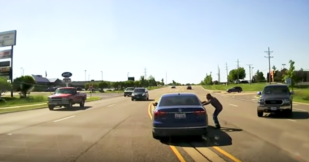 Man Jumps Into Moving Car To Save Driver Having A Seizure