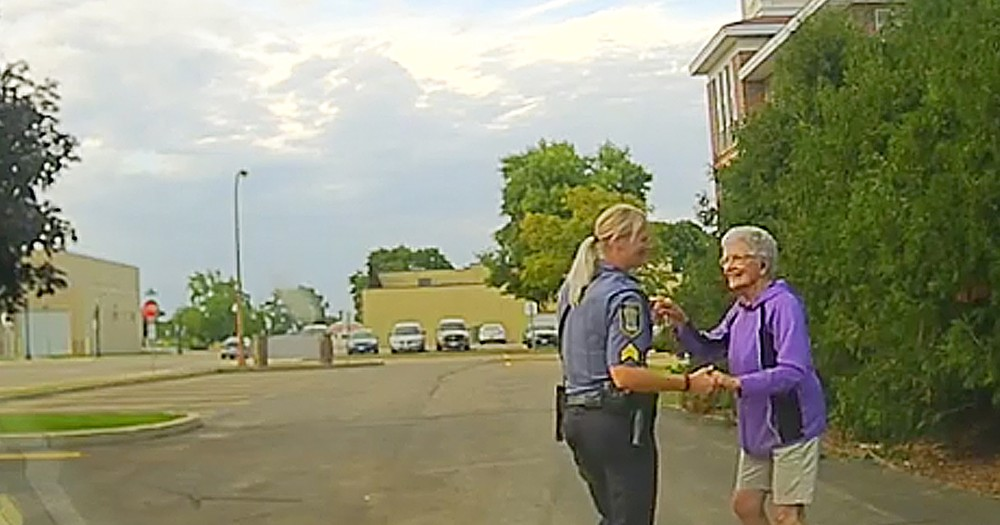 92-Year-Old Caught On Camera Sweetly Dancing With Police Officer