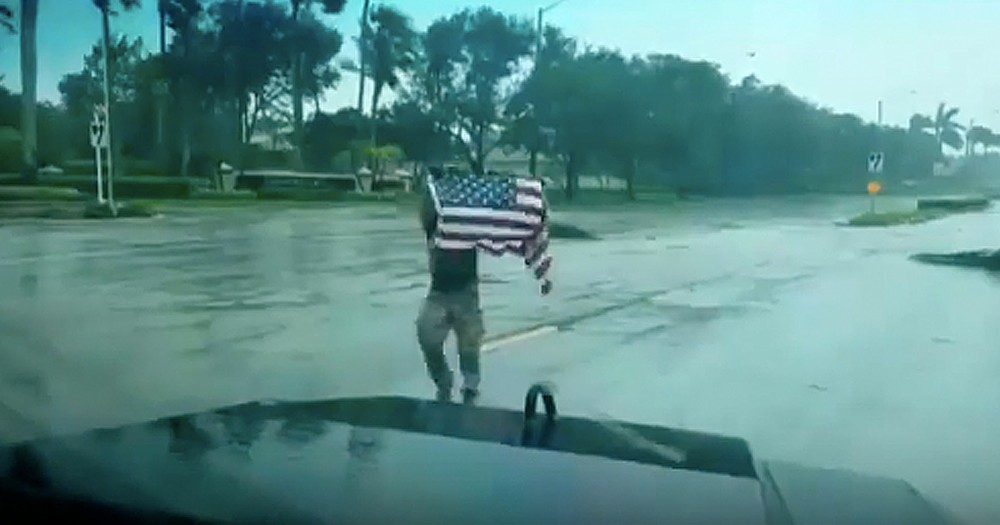 First Responder Rescuing Fallen American Flag During Hurricane Goes Viral