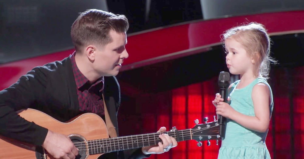 Little Girl Adorably Upstages Dad's Singing Audition On The Voice