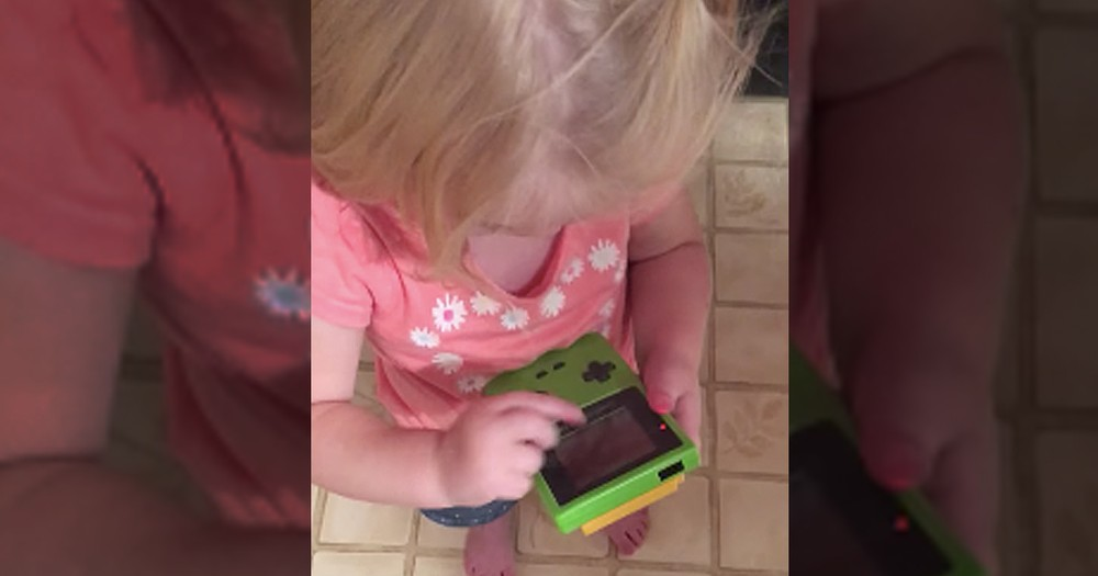 Adorable Toddler Can't Figure Out How To Play Gameboy