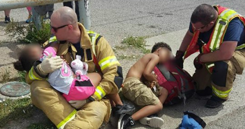 Compassionate Firefighters Comfort Scared Children After a Car Crash