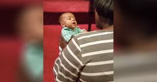 Tiny Baby Sings Along To Hymn At Church