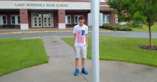 Mom Realizes Viral Photo Of Boy Standing Alone At Flagpole Is Of Her Son