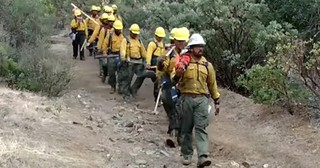 Firefighters Sing Breathtaking Hymn While Marching Down Mountain