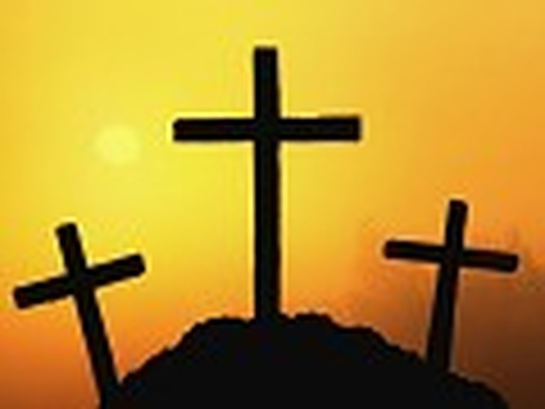 Three Crosses with an Orange Sky Background
