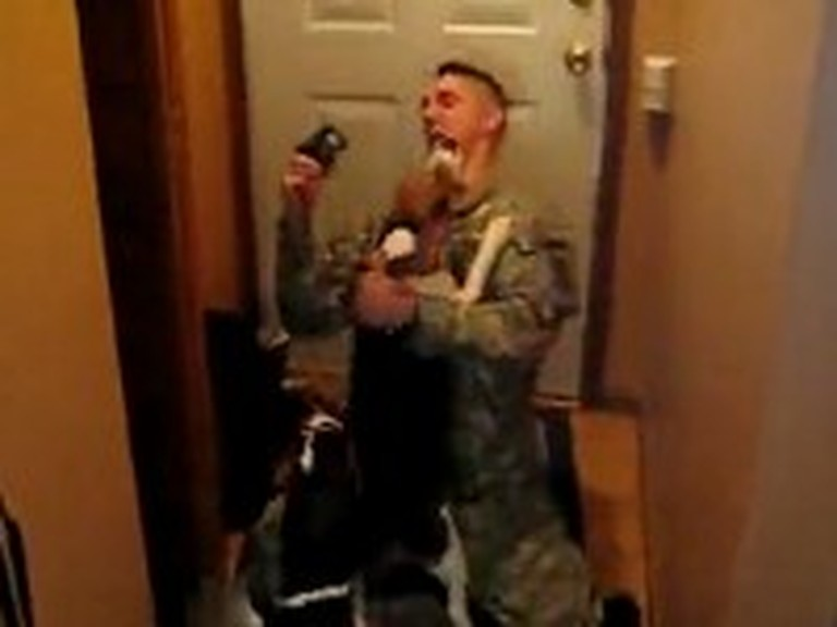 Soldier Comes Home to an Amazing Canine Greeting