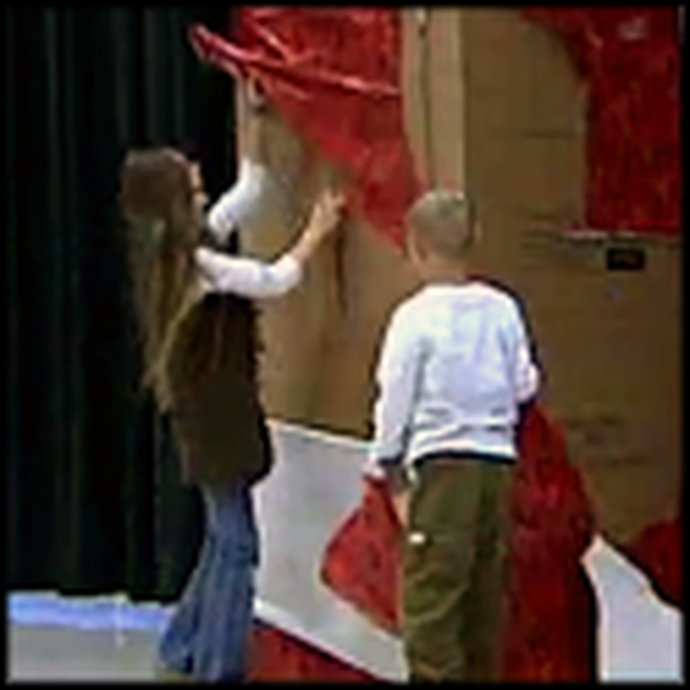 Brother and Sister Get the Best Gift on a School Stage