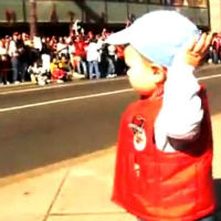 Watch One Cute Toddler Lead a Crowd of People in Cheers