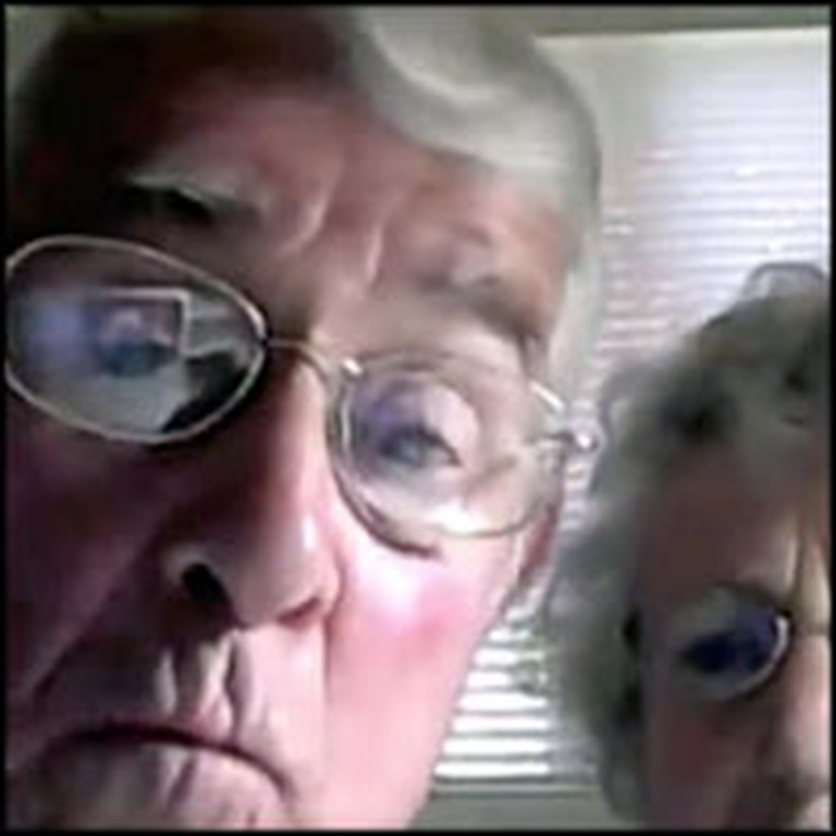 Cute Senior Couple Tries to Figure Out a Webcam