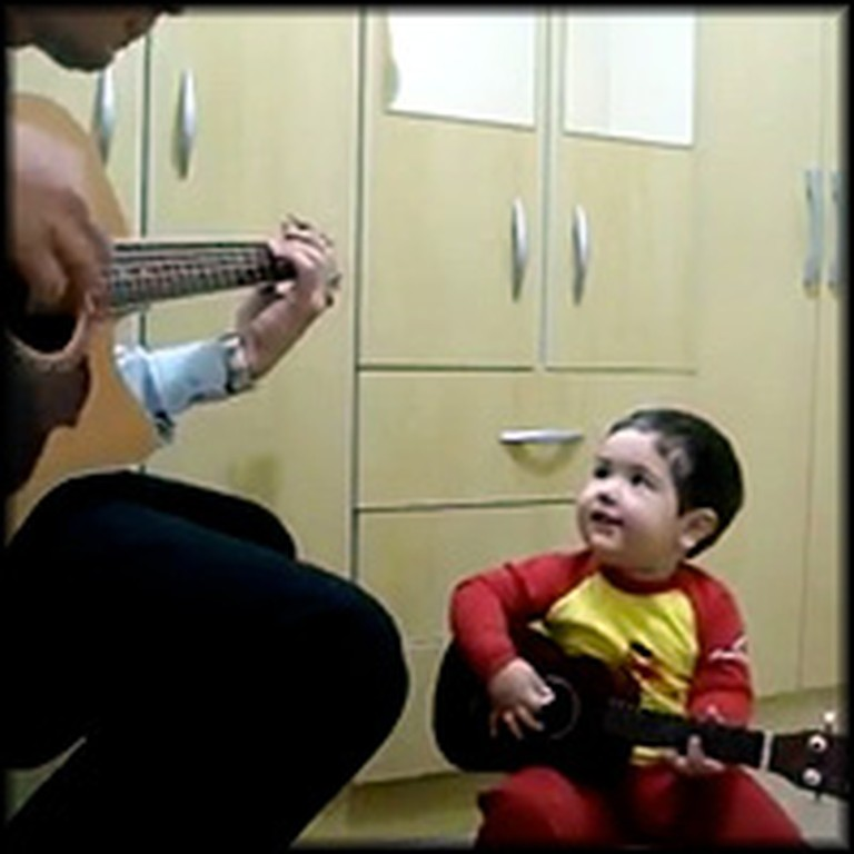 Adorable Baby Sings a Cute Duet with His Daddy