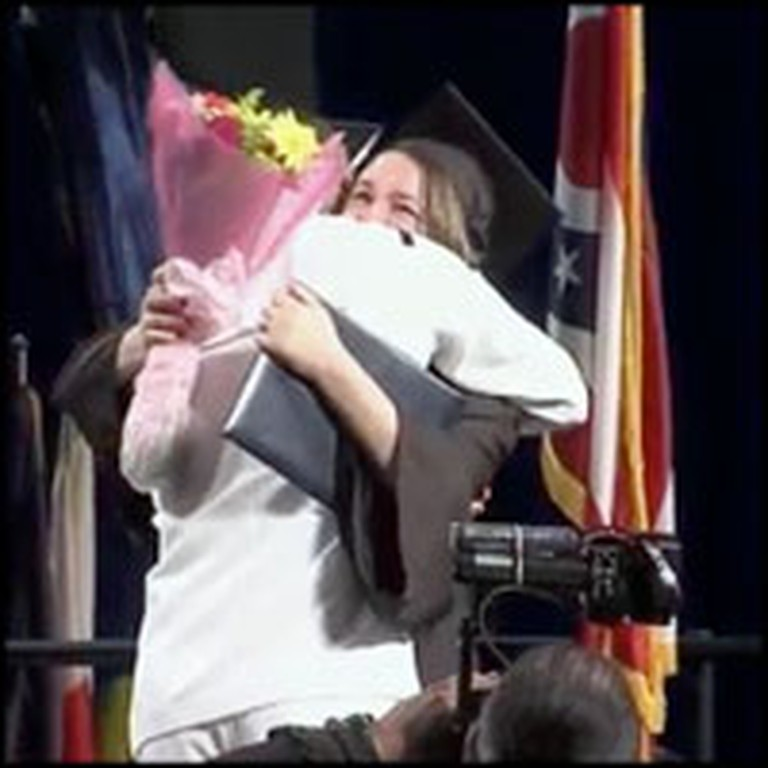 Navy Sailor Surprises His Wife in the Middle of Her Graduation Ceremony