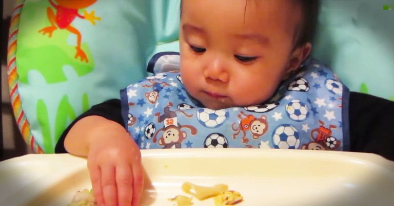 Cute Baby Eats In A Funny Sneaky Way