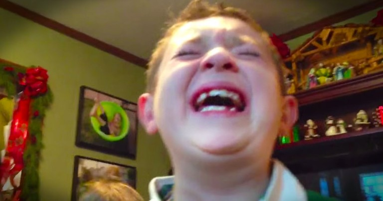 One Little Boy Can't Contain His Joy After Opening His Christmas Gift