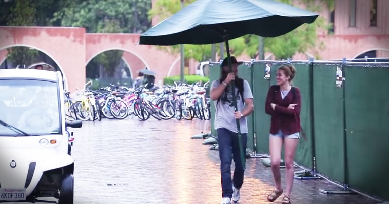 Kind Man Helps Strangers In the Rain With Giant Umbrella