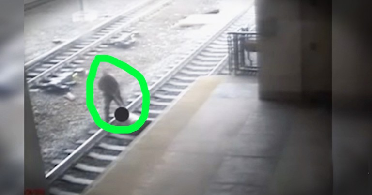 Officer Bravely Pulls Man Off Of Tracks Seconds Before Train Rolls By