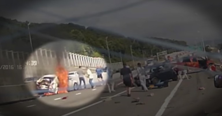 Hero Strangers Caught On Camera Saving A Woman From A Fiery Car