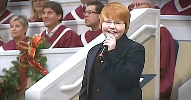 Young Boy Stands In Front Of Church And Sings 'Oh, What a Lovely Name'