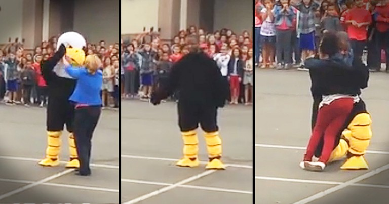 Marine Dresses Like Mascot To Surprise Daughter At School Assembly
