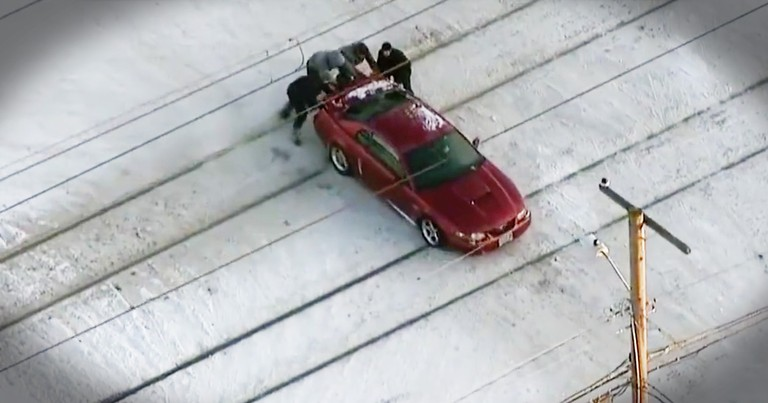 4 Good Samaritans Rescue Trapped Car Trapped On Snowy Tracks Moments Before A Train Comes