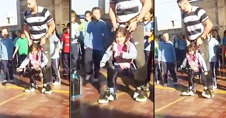 PE Teacher Helps Disabled Girl Dance With Class