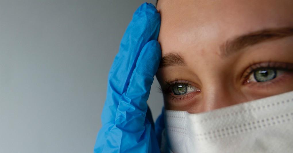 woman in distress wearing face mask and gloves coronavirus quarantine