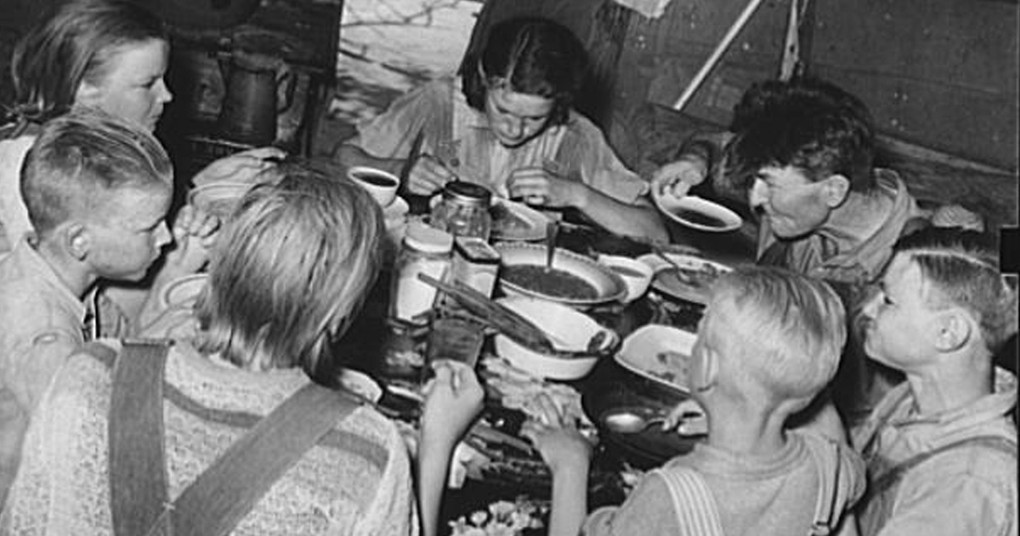 great depression family dinner table black and white photo