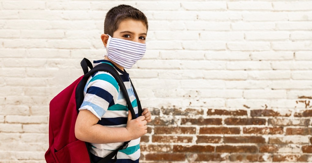young boy student wearing mask going to school, praying armor of god over returning students