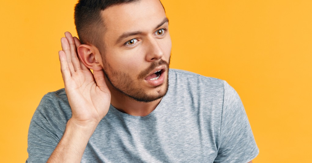 man leaning forward to listen intently