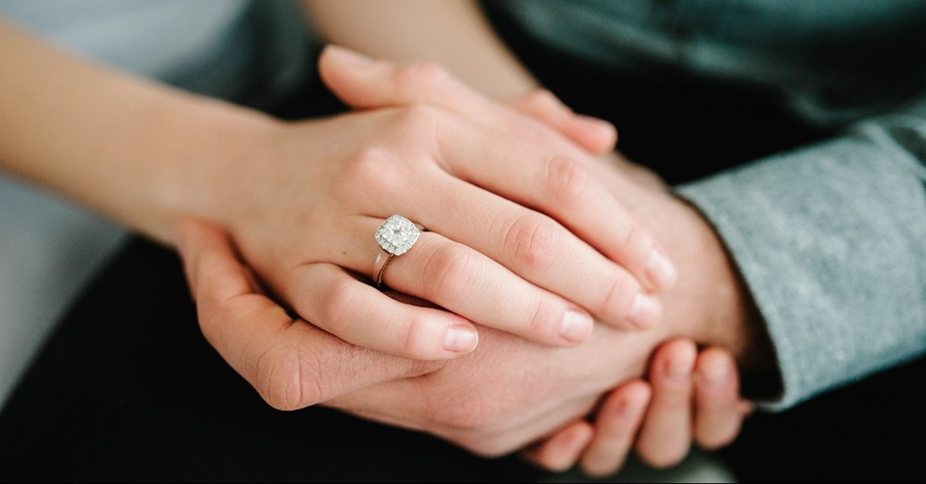 Husband and wife's hands clasped