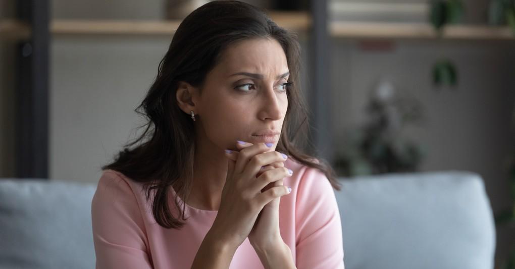 woman looking hopeless praying thankful grateful