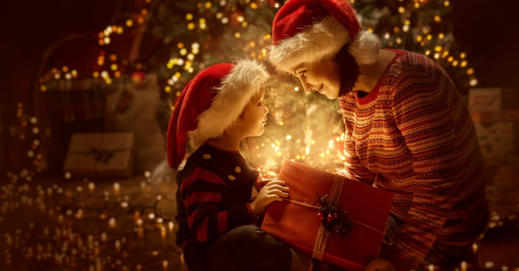 mother and son looking in magic present at christmas, best parts of christmas not presents