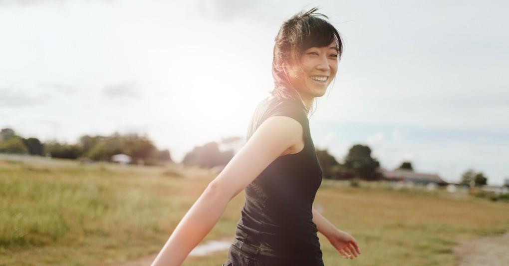 woman walking outside looking happy, how to spiritual retreat