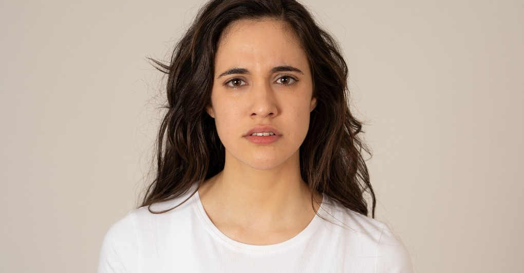 woman staring into camera looking worried and unsure, scriptures to read when you don't know who you are
