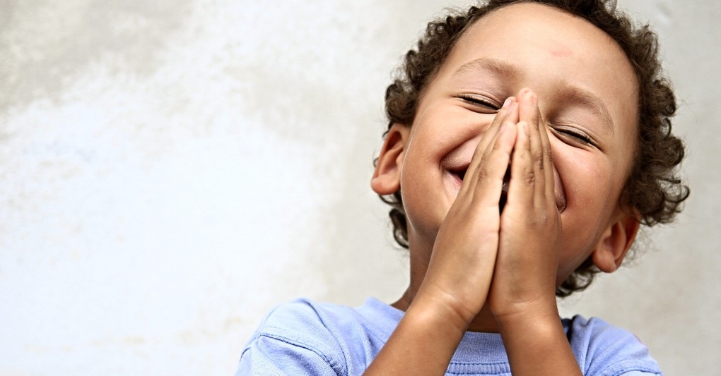 close up of little boy praying smiling looking cute and happy, praying lord's prayer for our children
