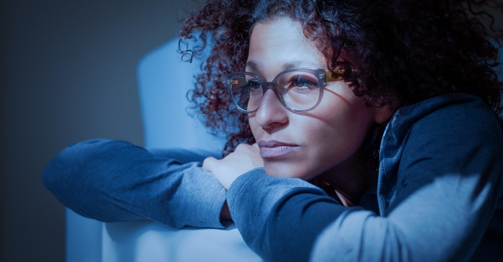 woman looking deeply thoughtful and concerned alone at night, things i wish the church taught about doubt