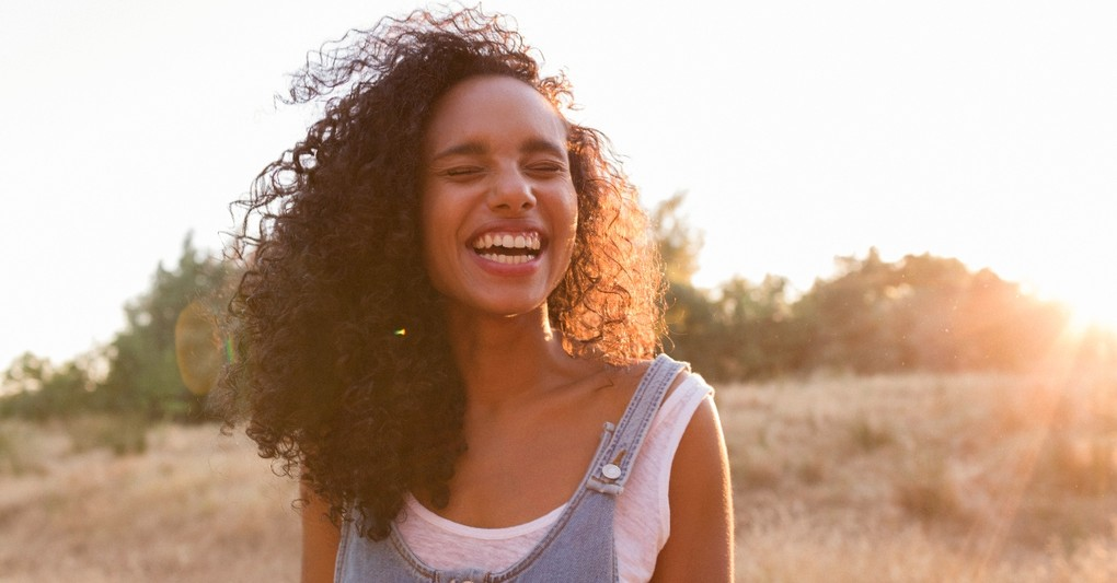 A woman smiling in the sunshine